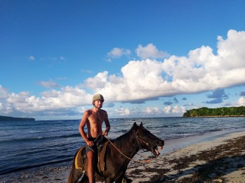 man on horse at the sea