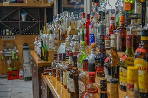 many different bottles of alcohol at the restaurante El Buen Cafe