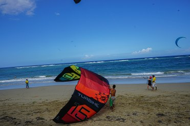 three man with kites on a beach in the Dominican Republic