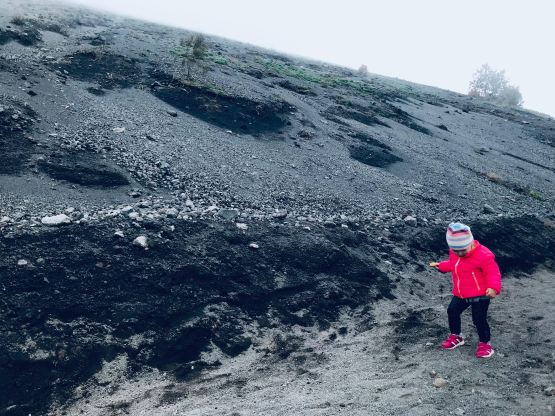 a child with red jacket on Mount Vesuvius
