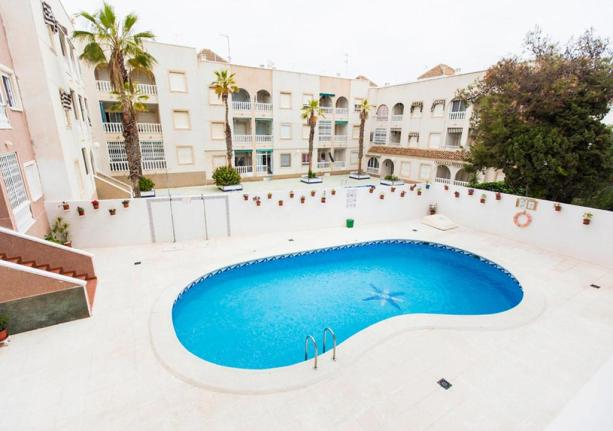 A swimming pool in a residential area in Torrevieja