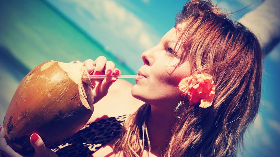 Woman-Drinking-Coconut-Water