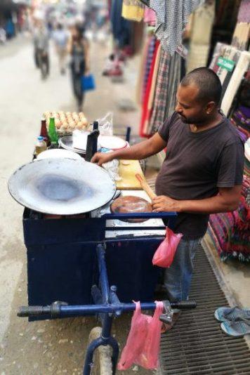 Street food vendor making tortillas