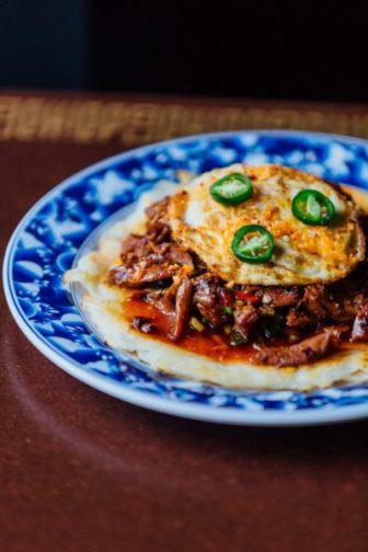 Chopped Duck in Black Bean Sauce, Crispy Rice Noodles, Fried Egg
