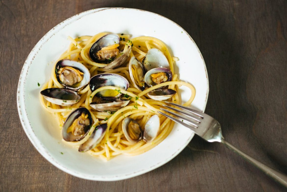 Pasta with clams are served in a Vieri bowl to guests as a simple dinner