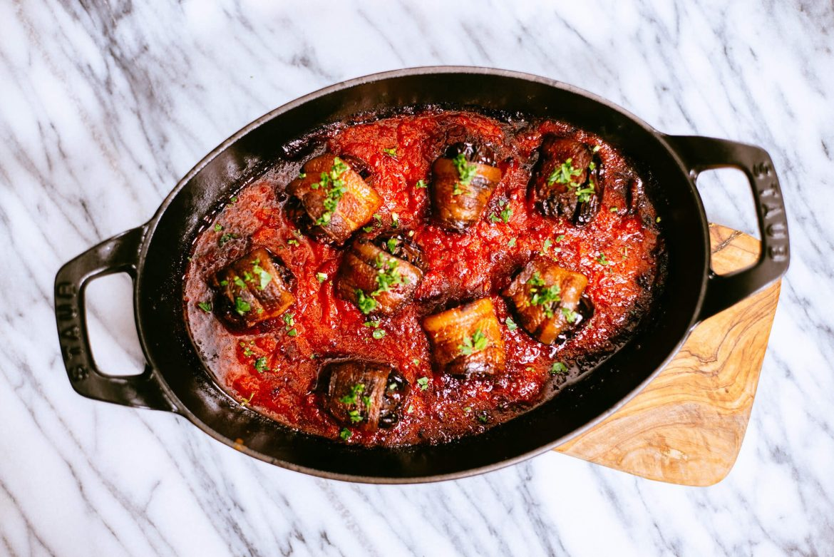 Finish your bacon wrapped chorizo stuffed dates with roasted bell pepper sauce