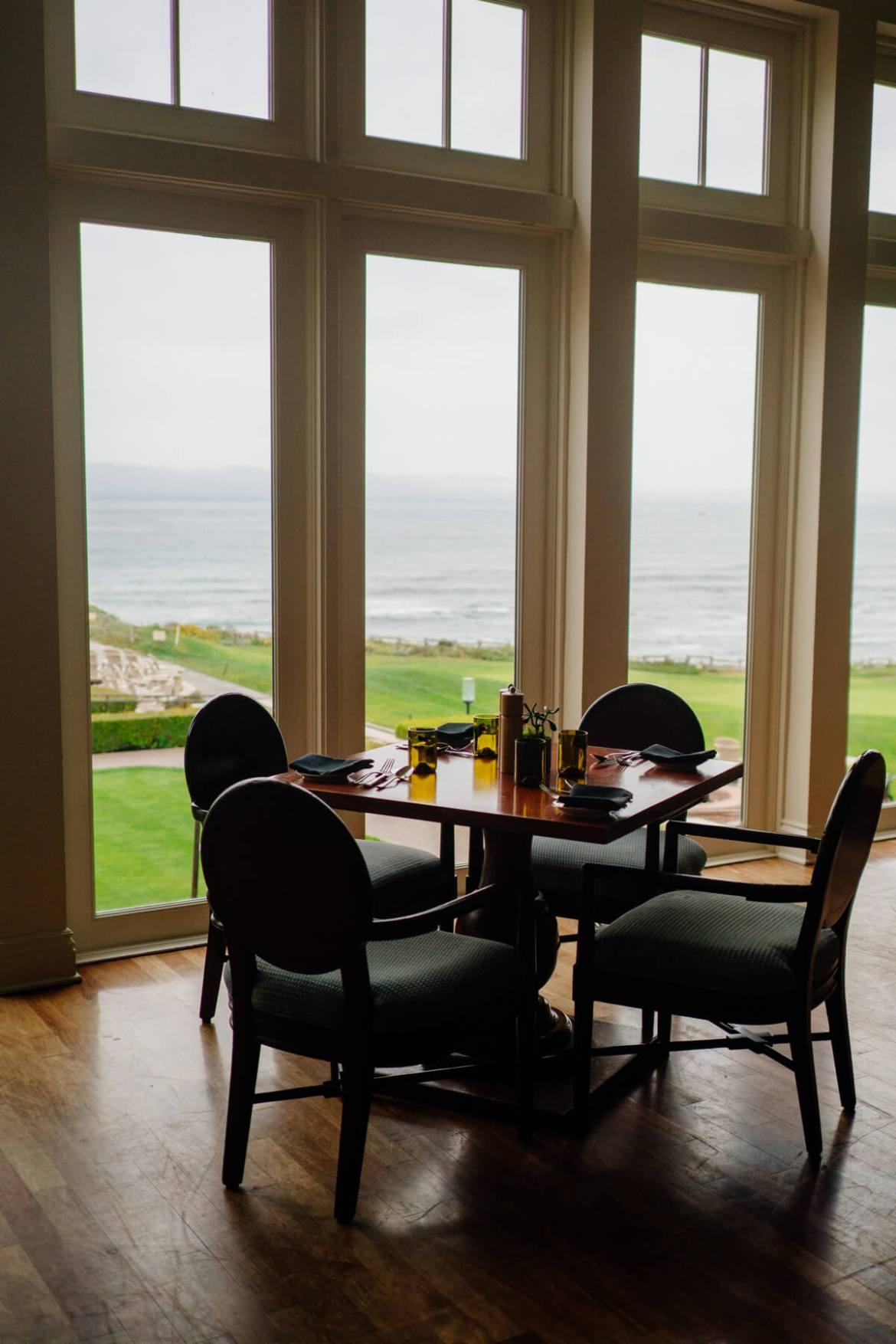 Large windows look over the ocean at The Ritz-Carlton Half Moon Bay
