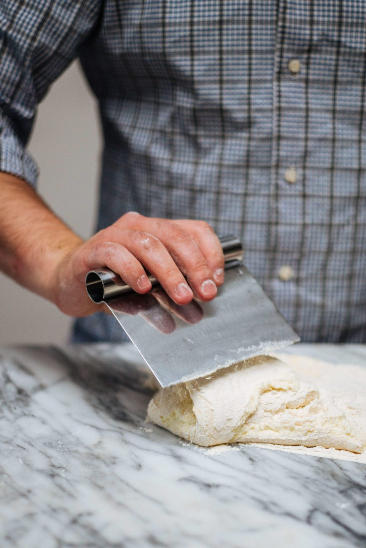 how to make Ricotta Gnocchi: mixing with pastry scraper