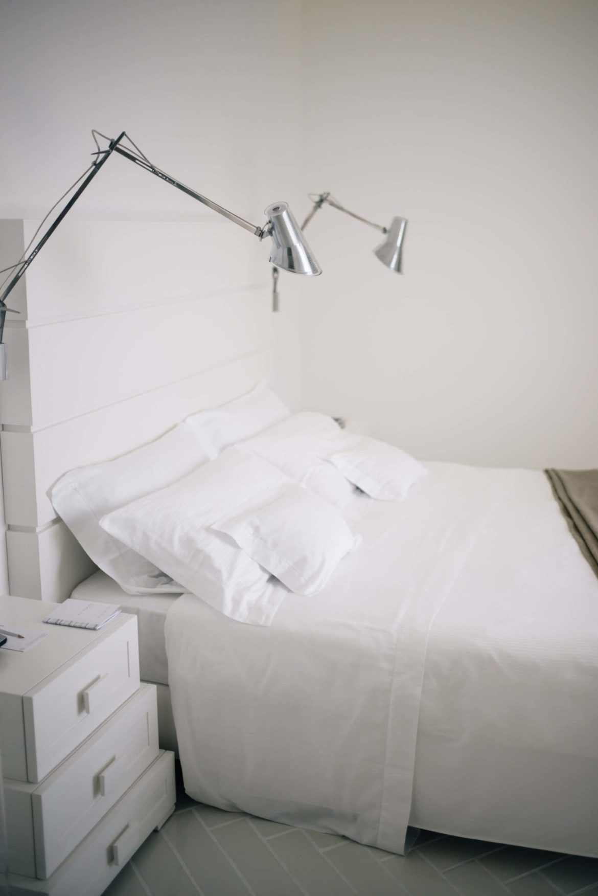 Bed and floss lamps at Casa Angelina Lifestyle Hotel in Praiano Italy, The Taste Edit