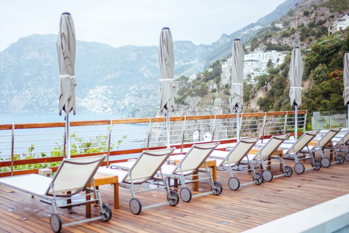 lounge chairs overlooking Positano at Casa Angelina Lifestyle Hotel in Praiano Italy, The Taste Edit