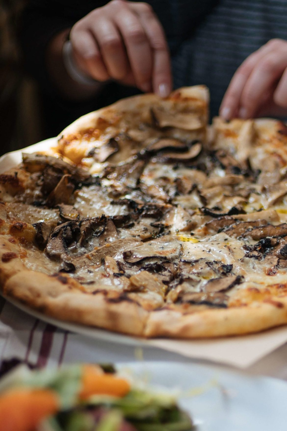 Stop at La Bicyclette in Carmel By The Sea, try the wood fired pizza Champignons, made with portobello and oyster mushrooms, mozzarella, thyme, caramelized onion and truffle, thetasteedit