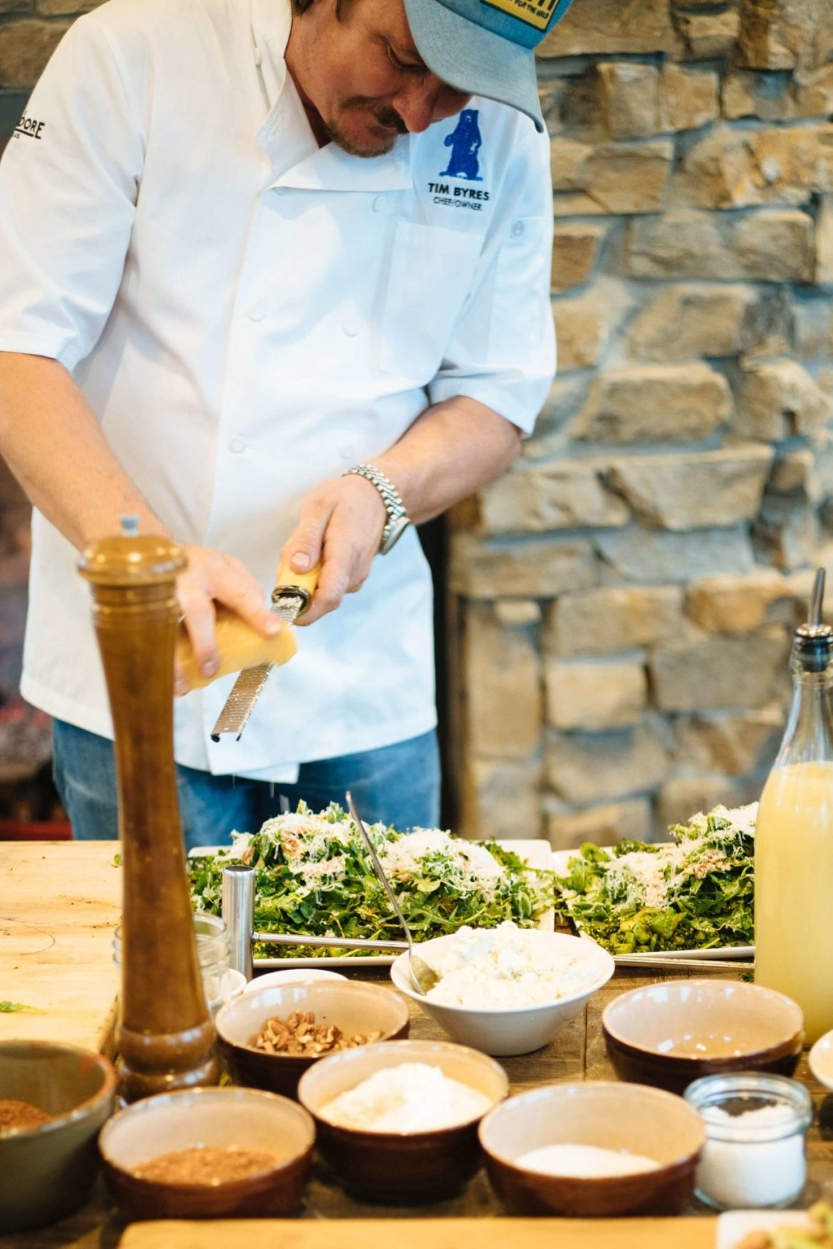 Make Tim Byres grilled broccoli rabe and arugula salad from his award winning smoke cookbook. The Taste Edit experiences it at their visit to Paws Up in Montana.