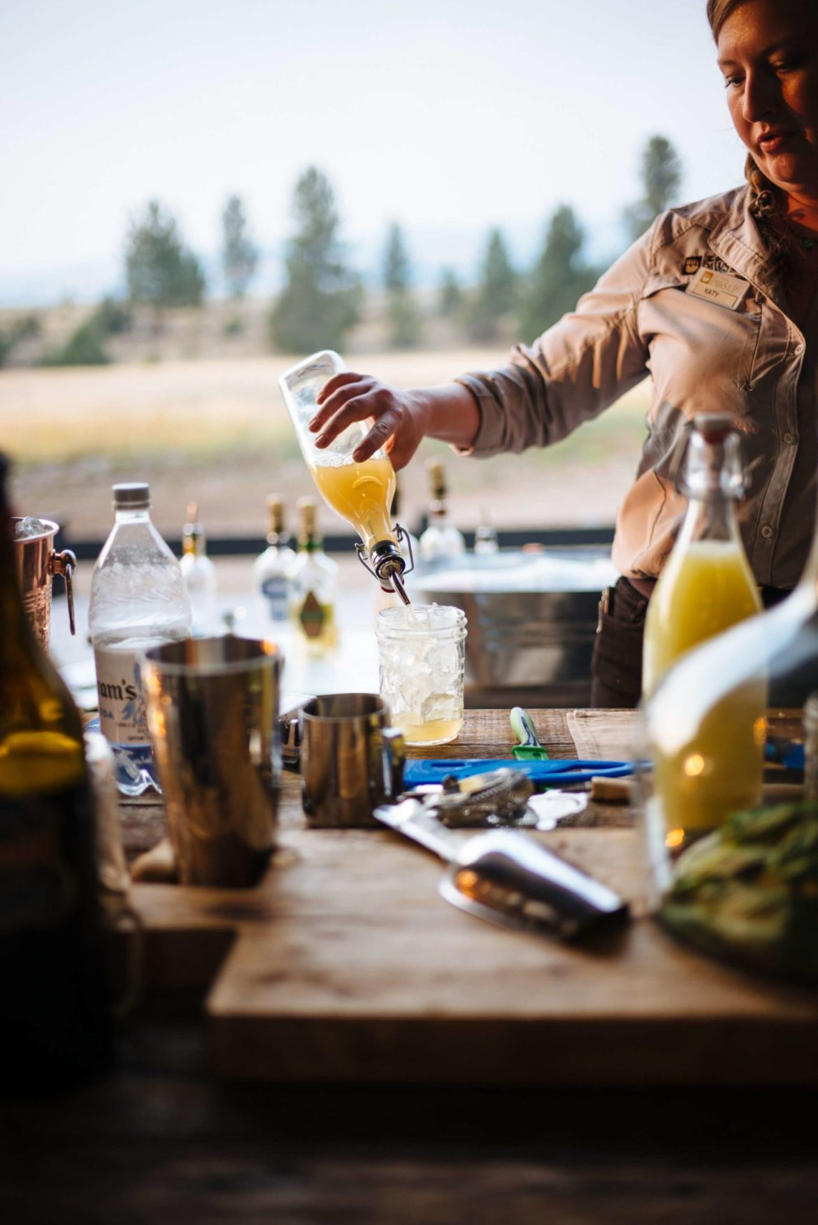 Make Tim Byres Woodshed Margarita made with tequila and cedar wood plank from his book Smoke. Photo by The Taste Edit from Paws Up in Montana.
