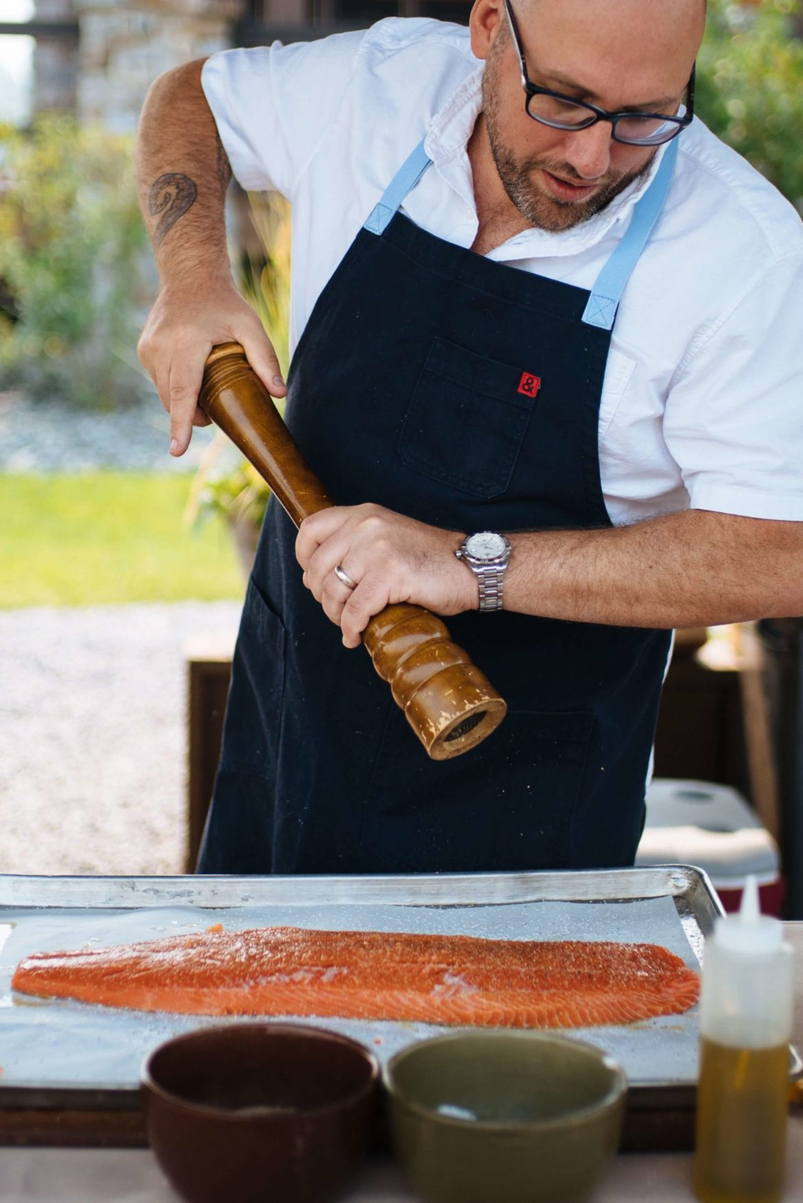 Chef's Grilled salmon recipe from the Dentons in Ox Portland, season salmon by salt and peppering the salmon, the resort at paws up, montana glamping, cookbook live, greg denton OX restaurant Portland, The Taste Edit