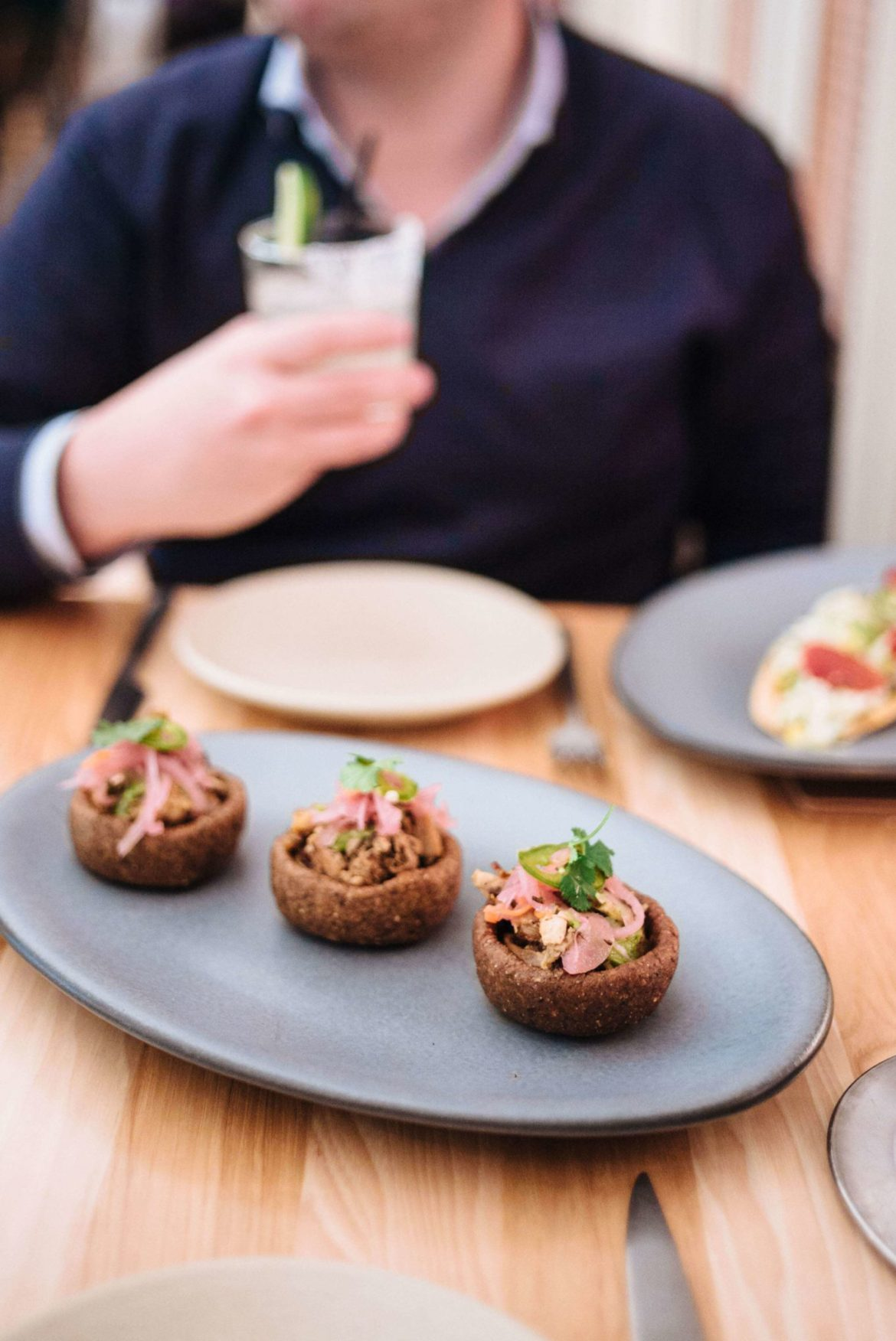 The Taste Edit Culinary and Travel bloggers and photographers visits ATX Cocina the best Modern Mexican Austin restaurant - try the sope cochinita pibil, bean puree, habanero-onion salsa