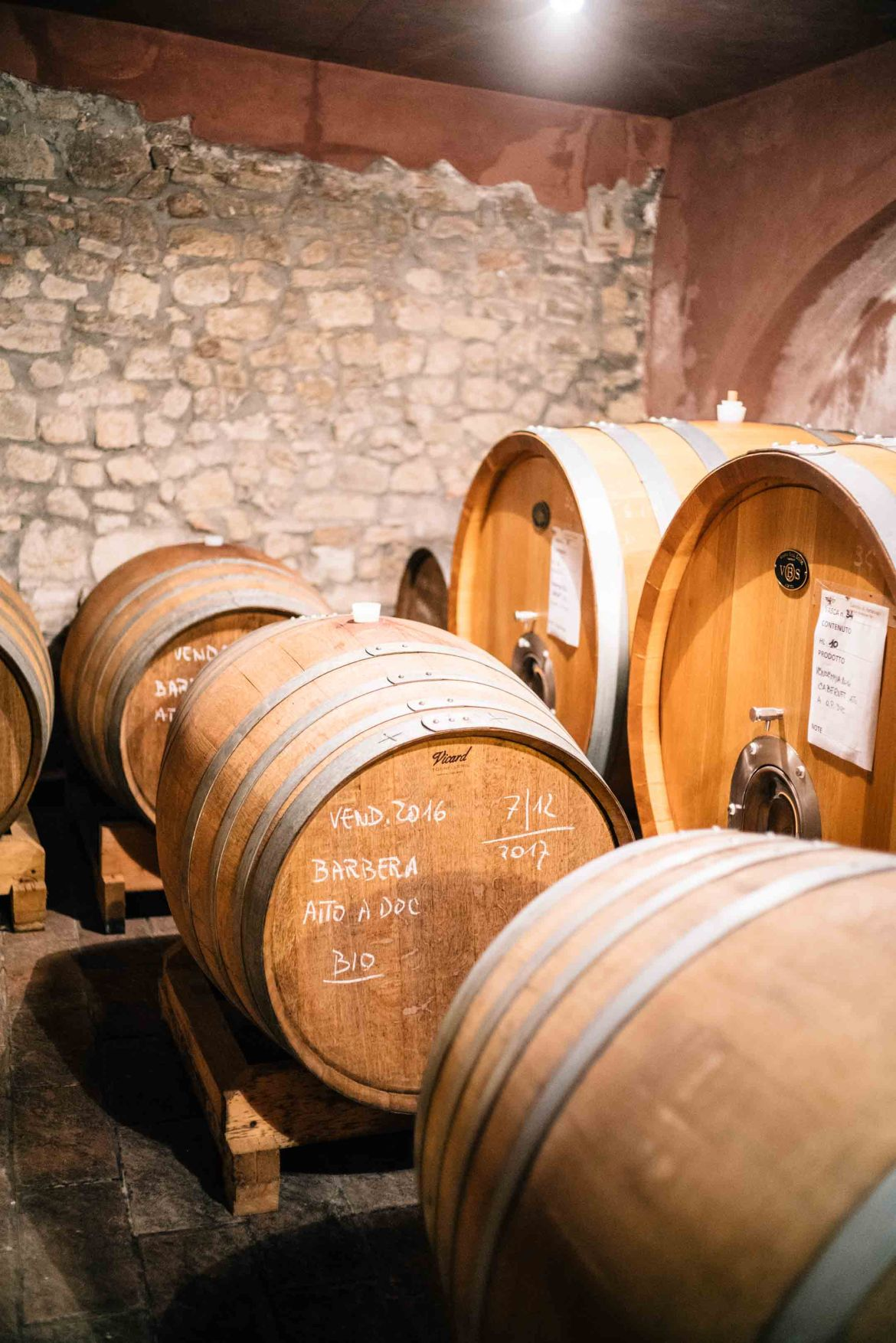 The Taste Edit, culinary photographers, recommends visiting this magical winery in northern Italy. Castello di Stefanago is near the town of Pavia in Lombardy. Winemaker and owner Giacomo Baruffaldi gives us a tour of the winery where they make Baruffaldi natural wines. Wine aging in barrels.
