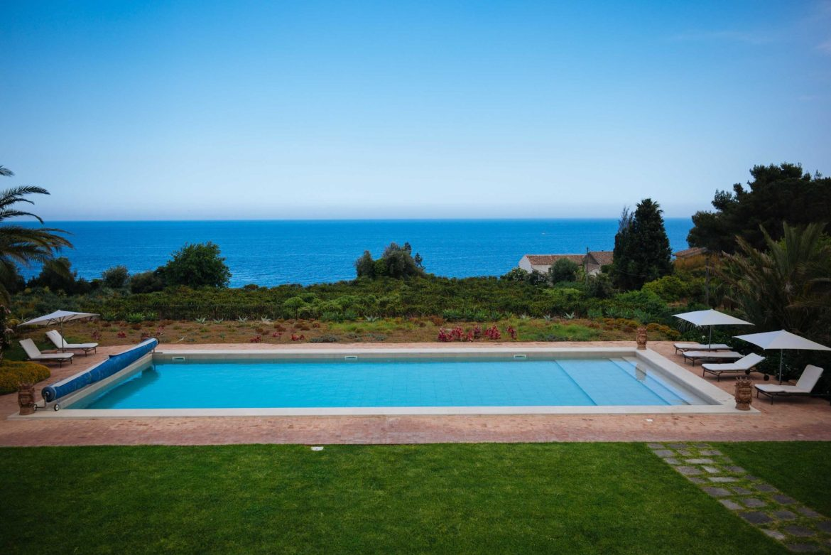 The Taste Edit dips in the pool over looking the sea at Villa Don Venerando in Sicily with the Thinking Traveler.