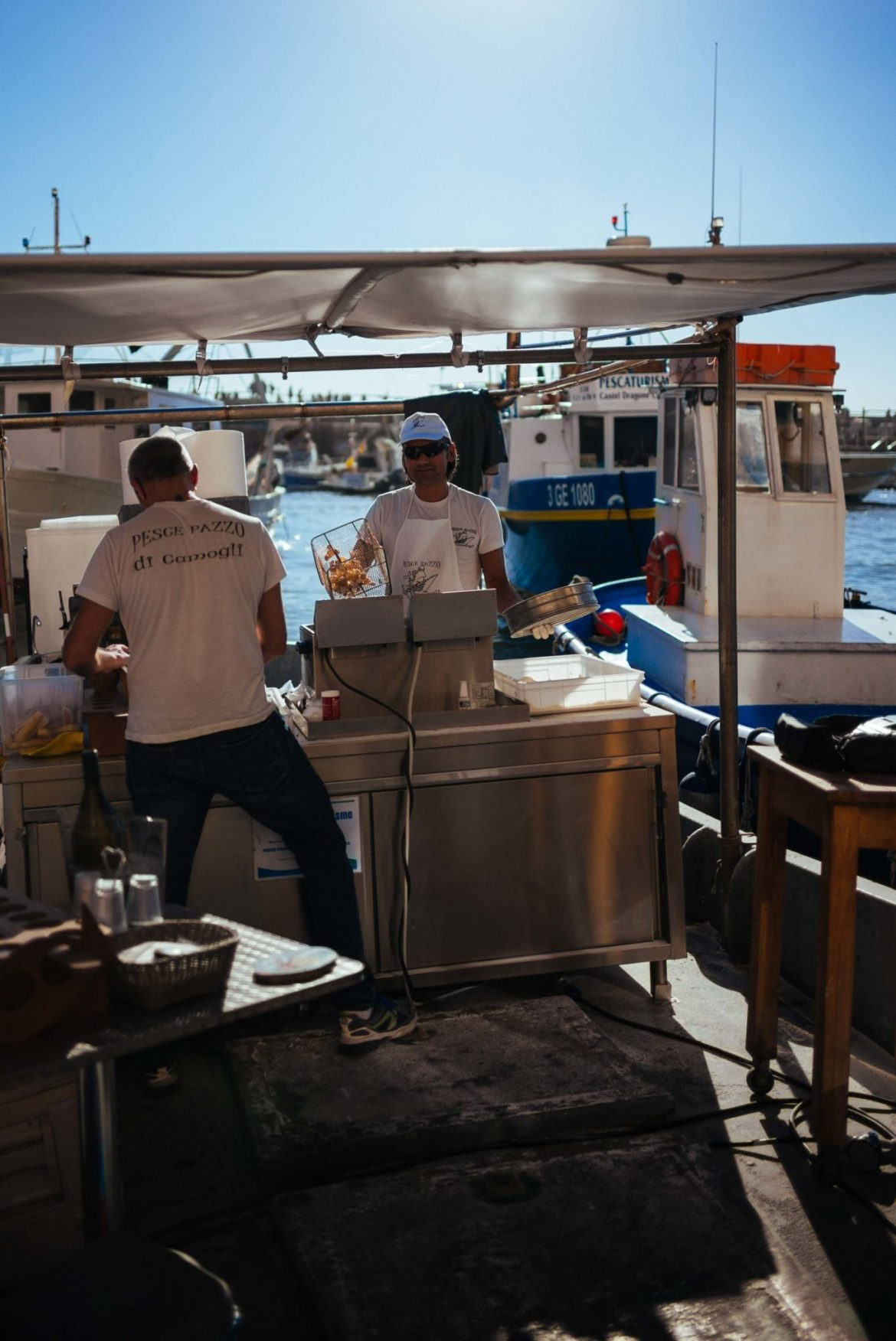 The Taste Edit recommends that you visit this Italian Beach town that no one knows about - Camogli, Italy. Fish is cooked and served from their boat.