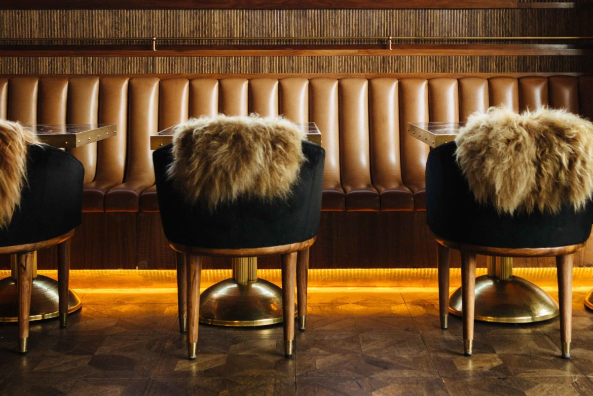 Glamour and old school steak house in San Diego - born and raised, an over-the-top steakhouse decor with dark jewel colors, flowers, fur throws, and gold