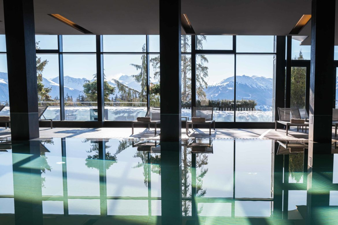 The view of the Alps from the pool at Crans Ambassador Hotel in Crans Montana, Switzerland. By The Taste Edit #spa #hotel #swiss