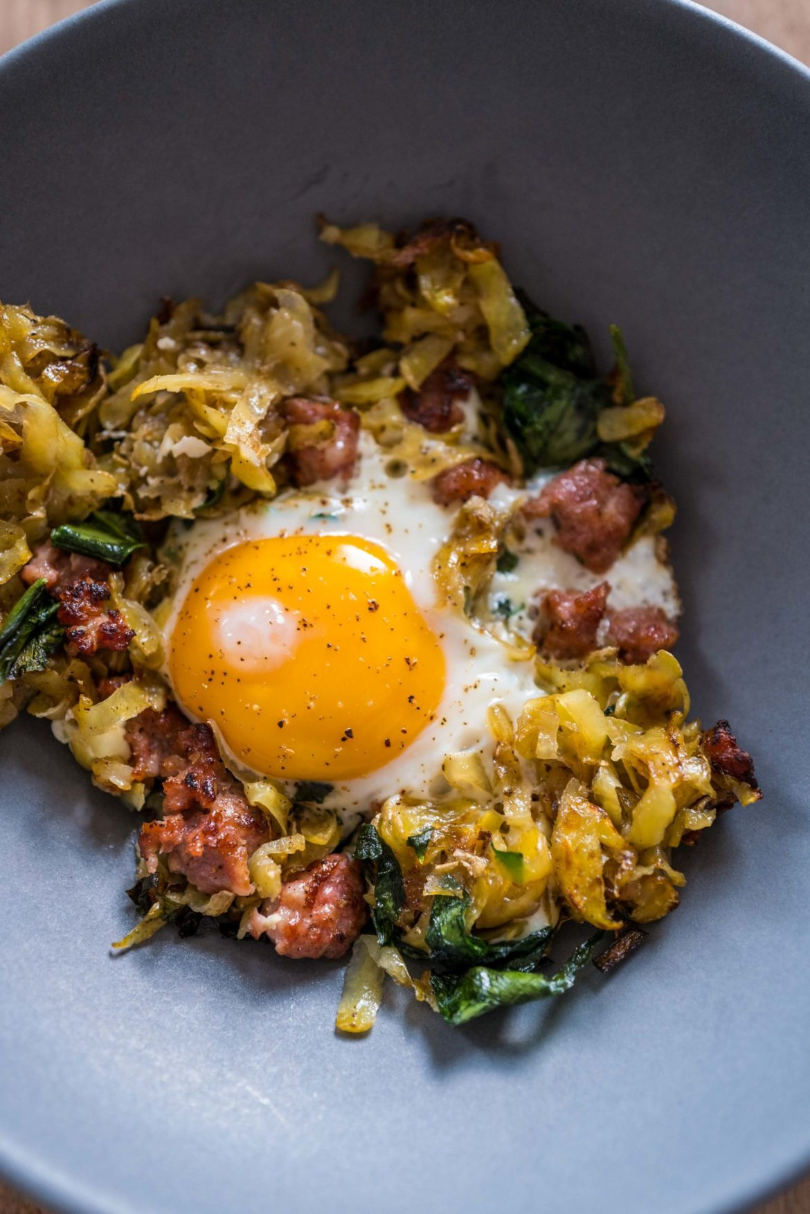 Make the best homemade hash browns recipe with crumbled sausage and ramps for breakfast this weekend. You can use wild garlic or kale if you don't have ramps. #recipe #breakfast #easy