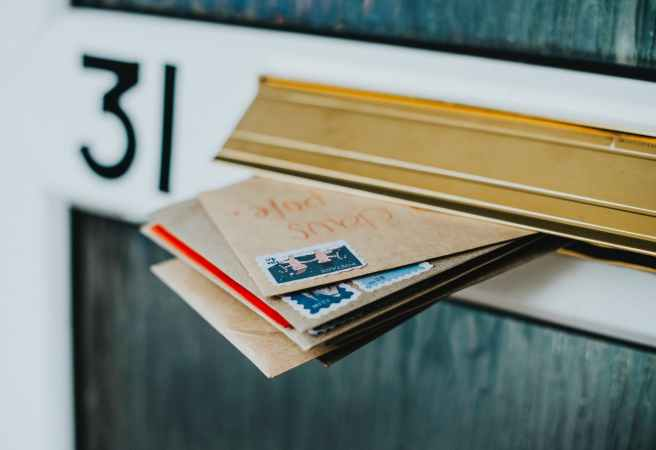 brown envelopes in mail box