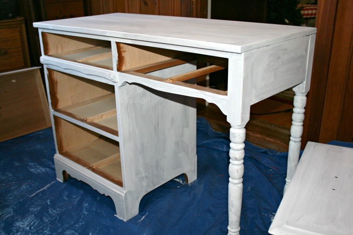 This desk was in great condition, but needed some help. Check out the results of my old-school wood desk makeover!