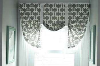 Want a custom window valance but can't afford the hefty price tag? Make your own! This DIY window valance was easy to make and turned out better than I imagined. It's requires very little sewing and only cost me $15!