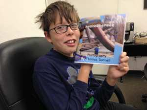 thomas-with-biggest-little-photographer-proof-book-10-4-16