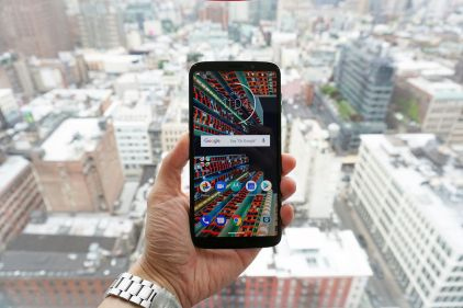 The screen's a new Super AMOLED with slimmer bezels than before. No notch!