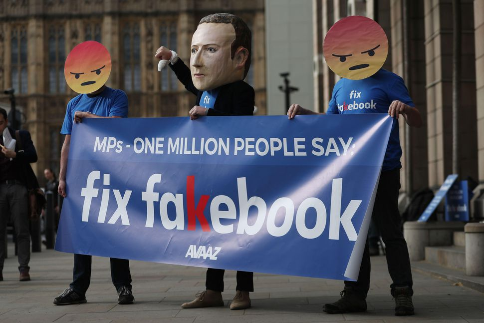 Protestors demonstrate in April outside a parliamentary hearing in London attended by Facebook's CTO.