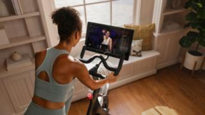 Peloton user following a live class from home