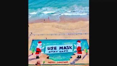 Santas hold huge mask to spread awareness in Sudarsan Pattnaik's sand art. Watch – it s viral