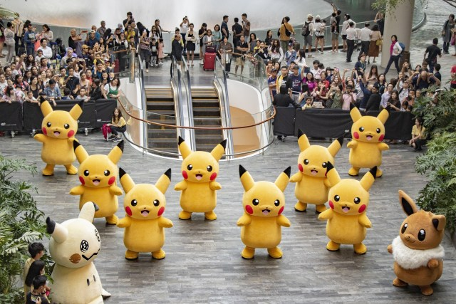 The Pokemon Parade of 8 Pikachu, 1 Eevee and 1 Mimkyu performing at the Jewel Changi Airport. Photo credit to Jewel Changi Airport Development (Via BusinessInsider.sg)