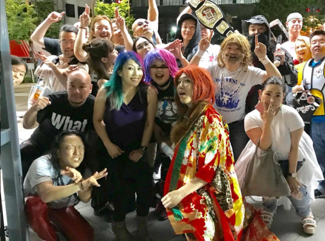 Asuka with fans via official Twitter (@WWE_Asuka)