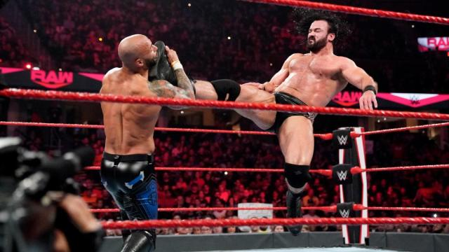 Drew McIntyre knocking down Ricochet with the Claymore via WWE.com
