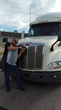 """Guru Of Geek"" Marlo Anderson in front of the Peterbilt Automated Driving Truck"