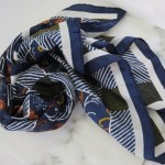 Navy and orange patterned scarf