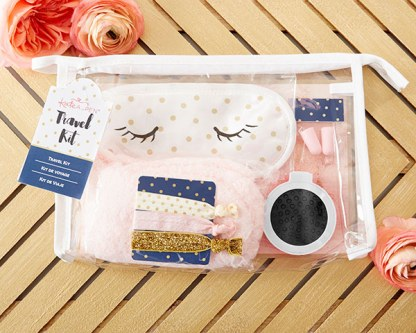 A clear plastic case with a polka dot eye mask that has closed eyes draw on, sparkly and polka dotted hairties, a hairbrush, and earplugs
