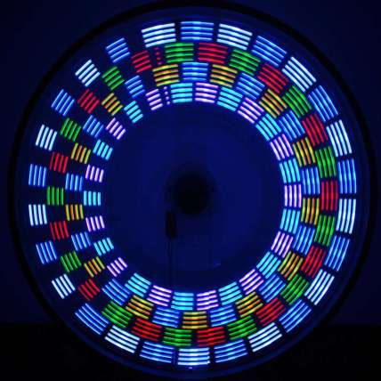 A circle of colorful lights on a bike wheel