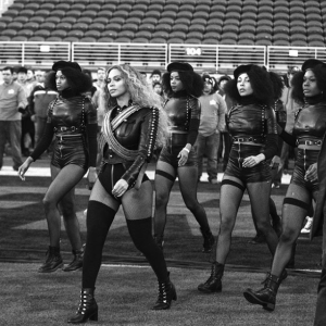 [Image description: Beyonce and her back up dancers donned in leather leotards and berets, wearing a militant fashion that is similar to the Black Panther's style] via Instagram / @beyonce