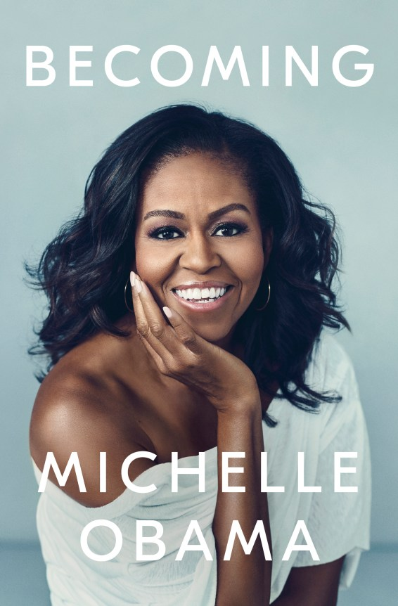 [Image description: cover of Michelle Obama's memoir titled Becoming. Michelle Obama is smiling with her chin on her palm on a light blue background.]