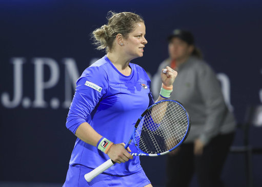 Kim Clijsters on court with racket