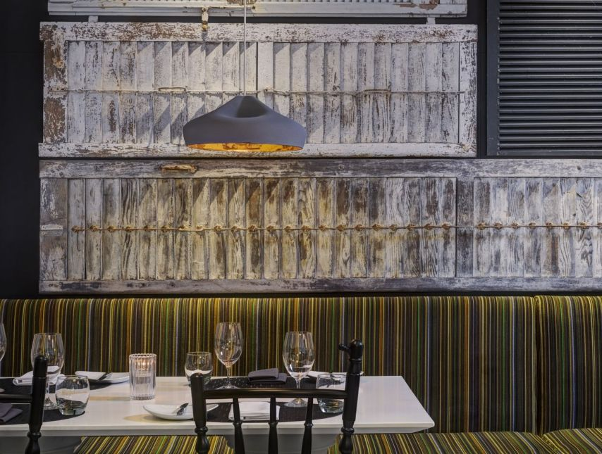 tennis-tourist-Hotel-Arts-Calgary-courtesy-Hotel-Arts-Group- Yellow-Door-Bistro-Belgian-Shutters-Paul-Smith-Banquettes