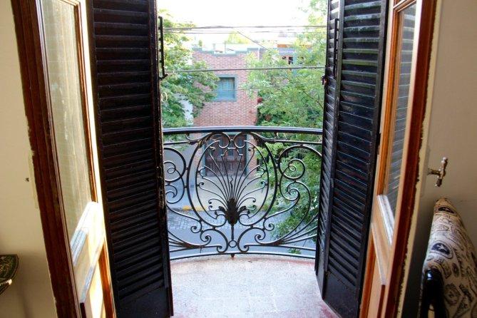 tennis-tourist-buenos-aires-argentina-ostal-redencion-balcony-teri-church