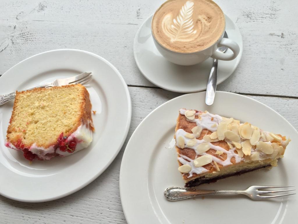 Lemon cake, Bakewell tart, flat white