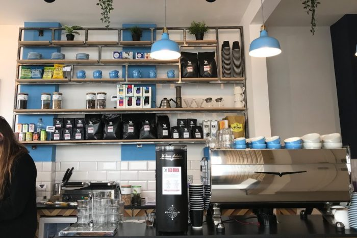 A view of the shelves behind the coffee counter