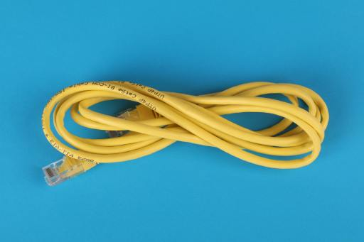 yellow ethernet cable on blue background pexels-ann-h-3541555