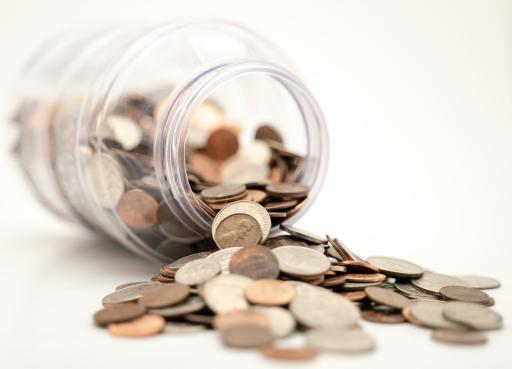 coins spilling out of jar. michael-longmire-lhltMGdohc8-unsplash