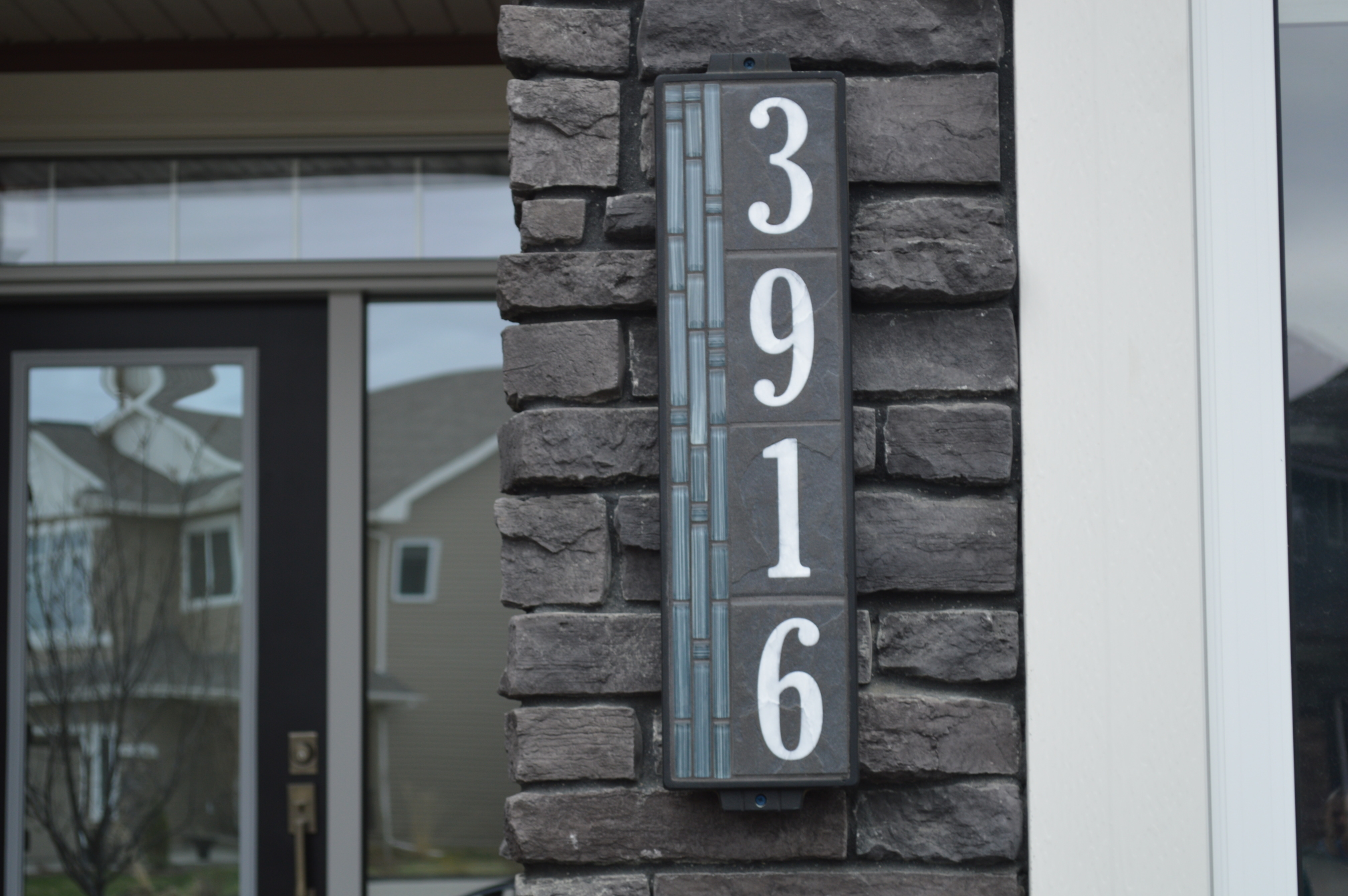 """6""""x24"""" Blue Bamboo House Number Sign Installed on a Home"""